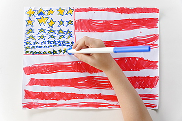 Boys (4-5) hand drawing US flag