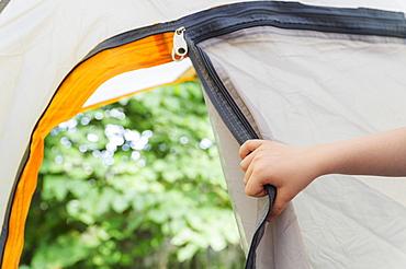 Boys (4-5) hand opening tent door