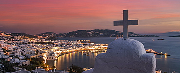 Greece, Cyclades Islands, Mykonos, Chora, Cross on church with coastal village in background