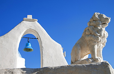 Greece, Cyclades Islands, Mykonos, Chora, Bell tower and lion statue of Paraportiani Orthodox Church