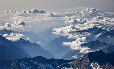 Switzerland, Monte Rosa, Aerial view of Monte Rosa Massif in clouds