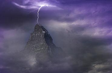 Switzerland, Canton Wallis, Zermatt, Matterhorn, Thunderstorm over Matterhorn covered with storm clouds