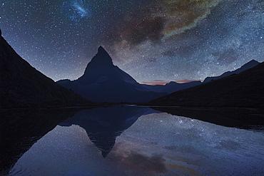 Switzerland, Canton Wallis, Zermatt, Matterhorn, Milky Way over Matterhorn reflecting in Riffelsee Lake