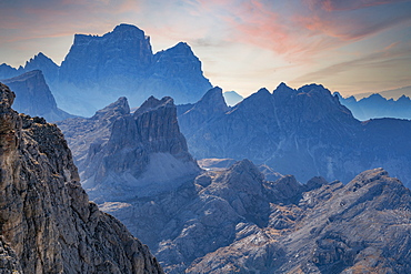 Italy, Veneto, Cortina D'Ampezzo, Dolomites, Rocky mountains ridges at sunset