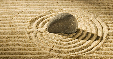 Still life of a stone on sand