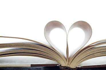 Book with pages folded in heart shape