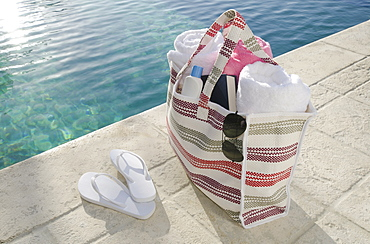 Sandals and bag at poolside