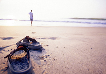 Person watching sunrise on beach