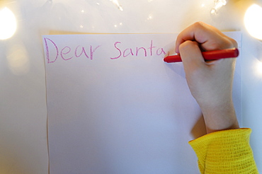 Hand writing letter to Santa Claus