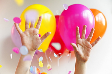 Hands with colorful balloons
