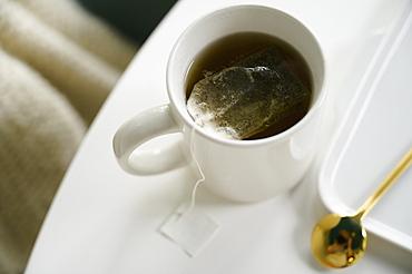 Mug with tea on table