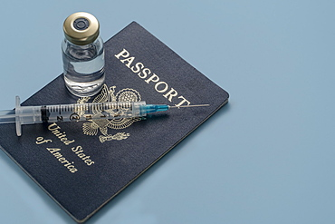 Covid-19 vaccine and syringe on US passport