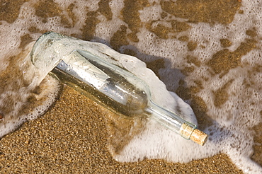 Message in bottle washing up on shore