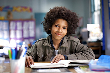 African American boy studying in classroom