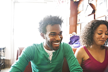 Smiling African American couple in diner