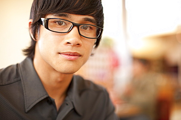 Close up of mixed race man with eyeglasses