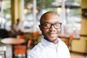 Black man smiling in coffee shop