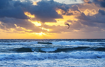 United States, Florida, Delray Beach, Kite surfer in ocean at sunrise