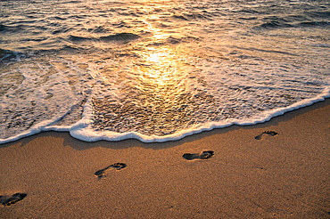 United States, Florida, Boca Raton, Footprints on beach at sunset