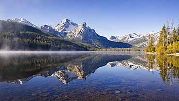 United States, Idaho, Sawtooth Lake surrounded with snowcapped Sawtooth mountains
