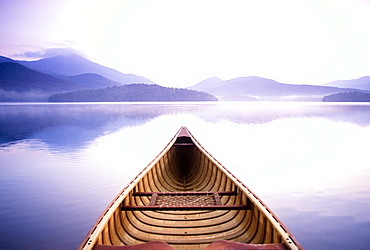 United States, New York, Lake Placid, View of Whiteface Mountain from wooden canoe on Lake Placid
