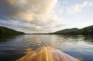 United States, New York, Lake Placid, Wooden boat on Lake Placid at sunset