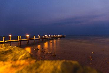View of sea and pier at night, Kep, Cambodia