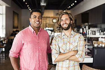 Portrait of two men in coffee shop