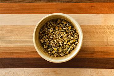 Loose leaf chamomile tea, overhead view, close-up