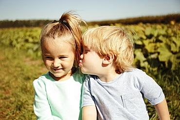 Boy kissing girl on cheek