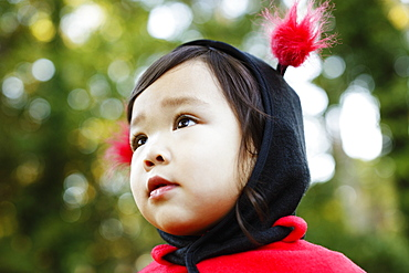 Young girl dressed up as ladybird