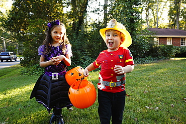 Two children trick or treating