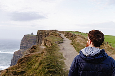 Mid adult man on The Cliffs of Moher, The Burren, County Clare, Ireland