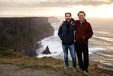 Two male friends on The Cliffs of Moher, The Burren, County Clare, Ireland