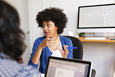 Woman in discussion in Small Business, Start-up