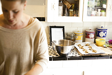 Mid adult woman busy in kitchen