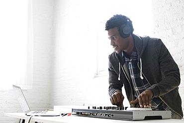 DJ using mixing desk