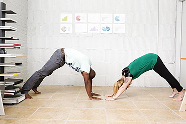 Young business partners exercising in design office