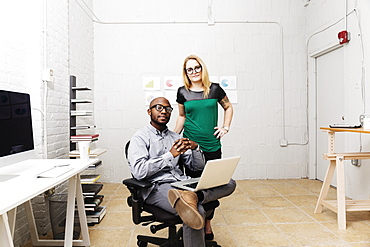 Portrait of young business partners in design office