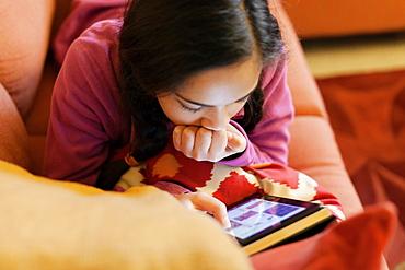 Teenage girl with electronic book