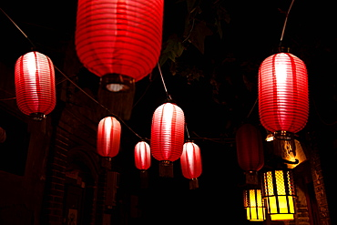 Paper lanterns on city street at night