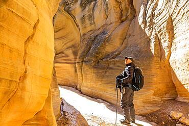 USA, Utah, Escalante, Man hiking in slot canyon in Grand Staircase-Escalante National Monument