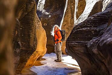 USA, Utah, Escalante, Woman hiking in slot canyon in Grand Staircase-Escalante National Monument