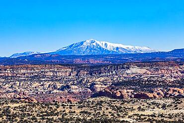 USA, Utah, Escalante, Distant snowy mountains in rocky landscape of Grand Staircase-Escalante National Monument