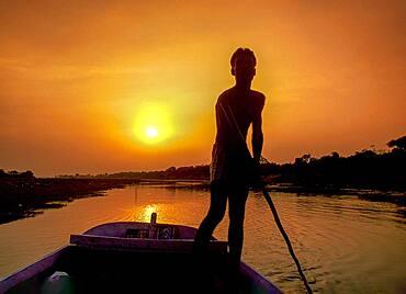 India, Agra, Boatman at sunset