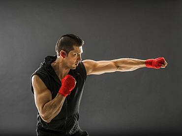 Muscular man training boxing
