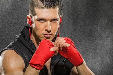 Portrait of muscular man in boxing stance