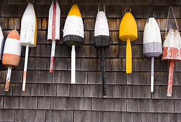 Buoys on the side of a wall in Maine