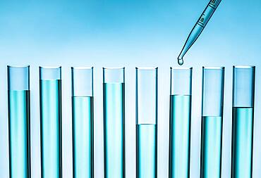 Pipette dropping liquid into test tube