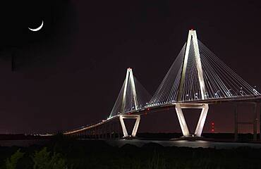 USA, South Carolina, Mount Pleasant, Arthur Ravenel Jr Bridge illuminated at night